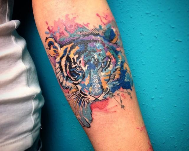 65 Tatuagens de tigres criativas e inspiradoras