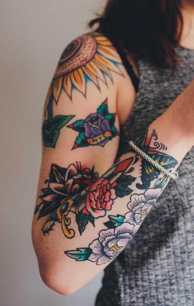 Faça uma mistura de símbolos na hora de tatuar seu ombro.