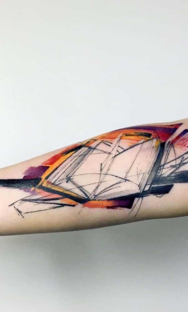 Outro modelo de tatuagem livros aquarela só que com o livro aberto.